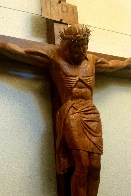 A photo of a large carved crucifix from the Church of Saint Andrew in Elk River