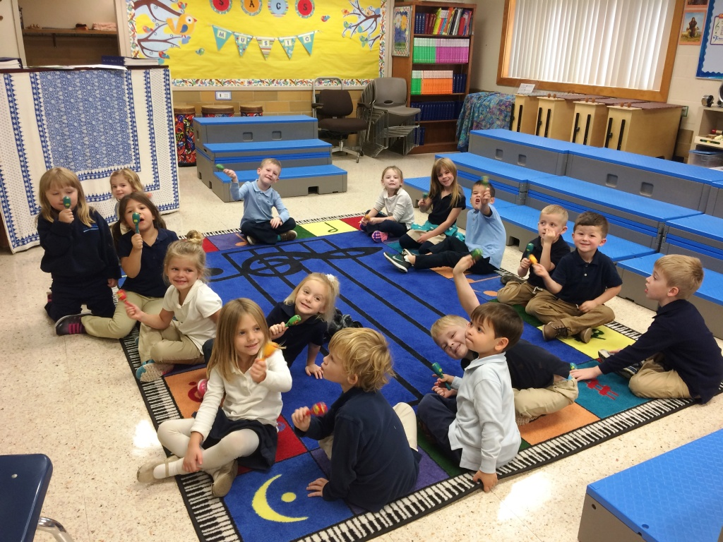 Pre-K students playing maracas during music class