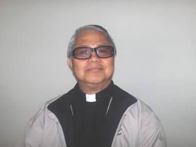 Photo of Fr Armando Red