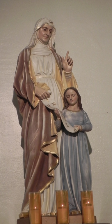Statue of Sainte Anne teaching her young daughter