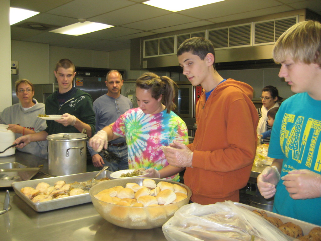 Youth making food for soup kitch