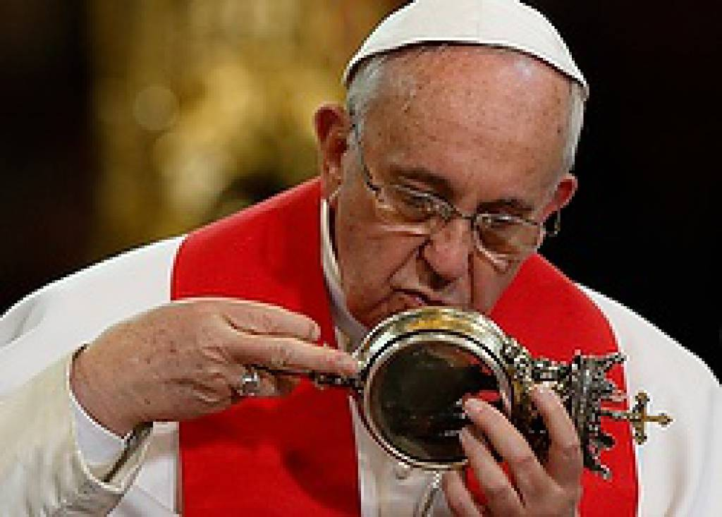 Pope kisses reliquary