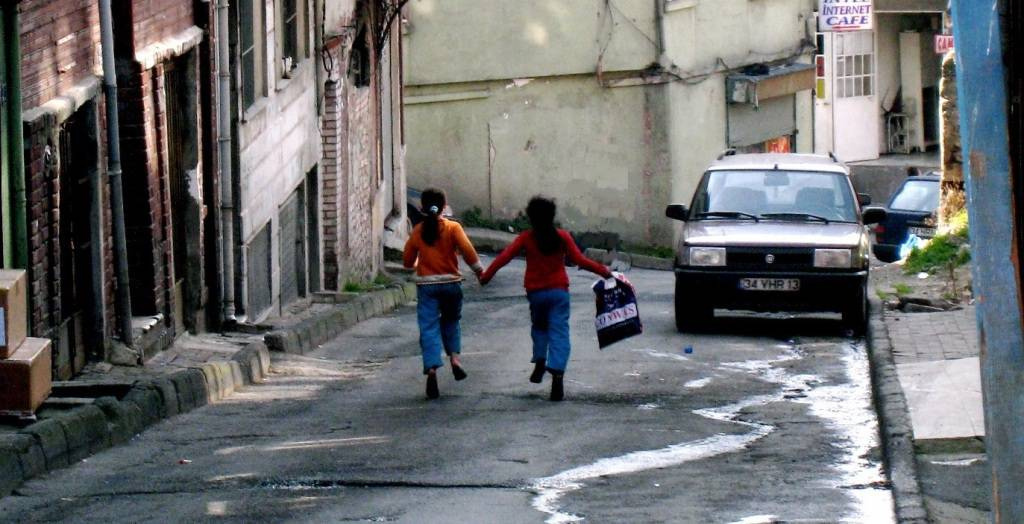 Children running holding hands
