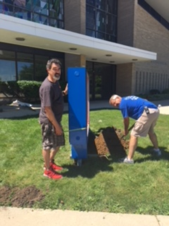 Installing our new sign at Whitnall & Norwich