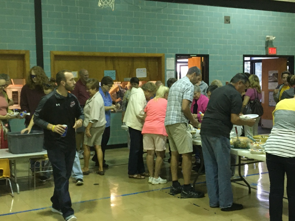 Attendees go through the food line.