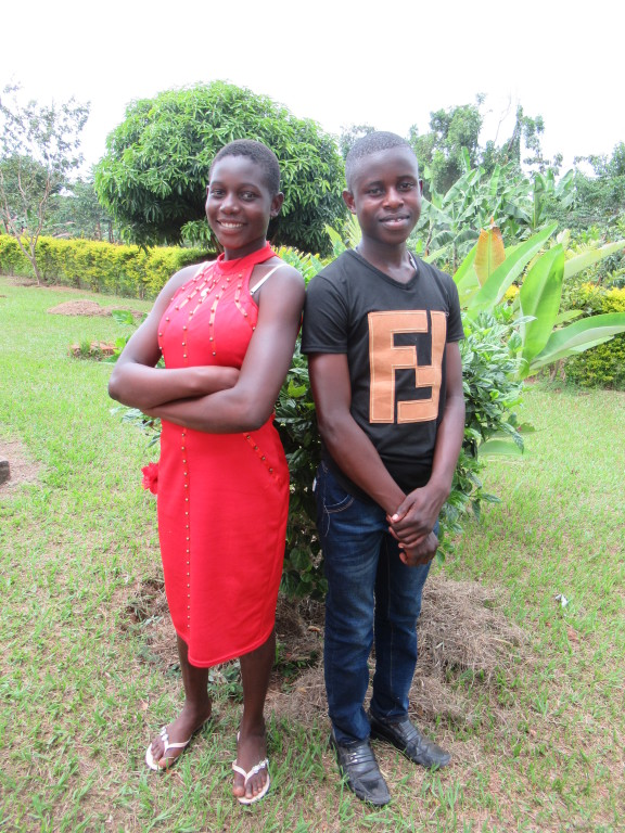 Flavia with her brother, Michael, in Uganda