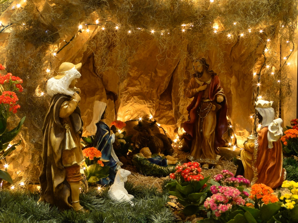 Christmas scene with Mary, Joseph and Baby Jesus, along with an ox and an ass