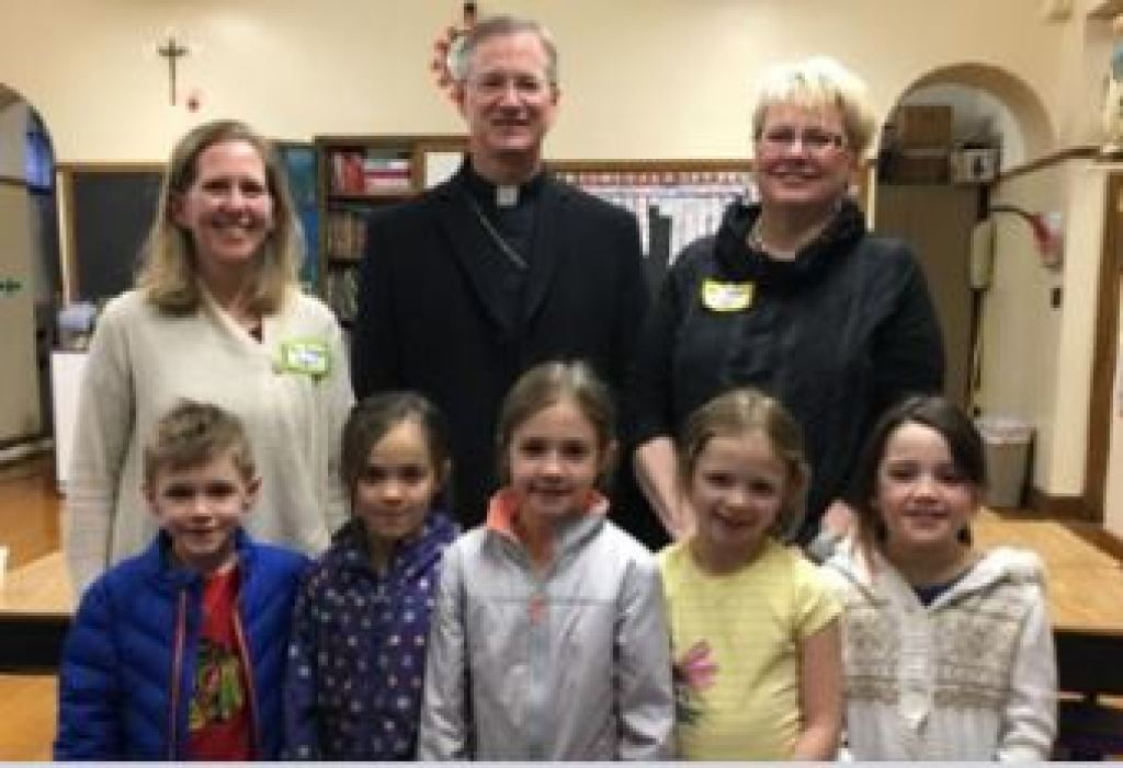 Bishop with Teachers and Students