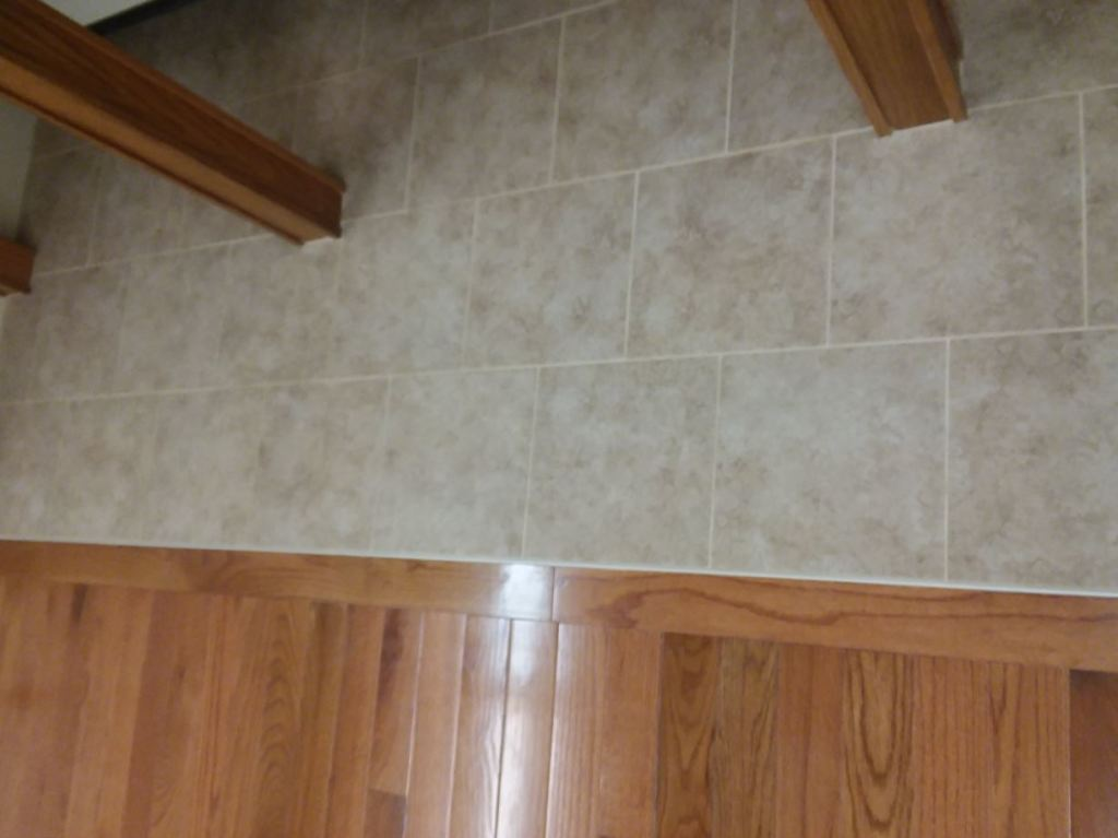 Closeup of wood flooring and tile