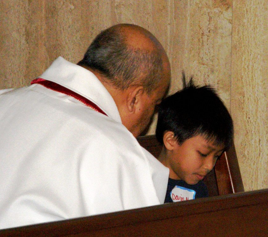 Fr. Peter hears a First Confession