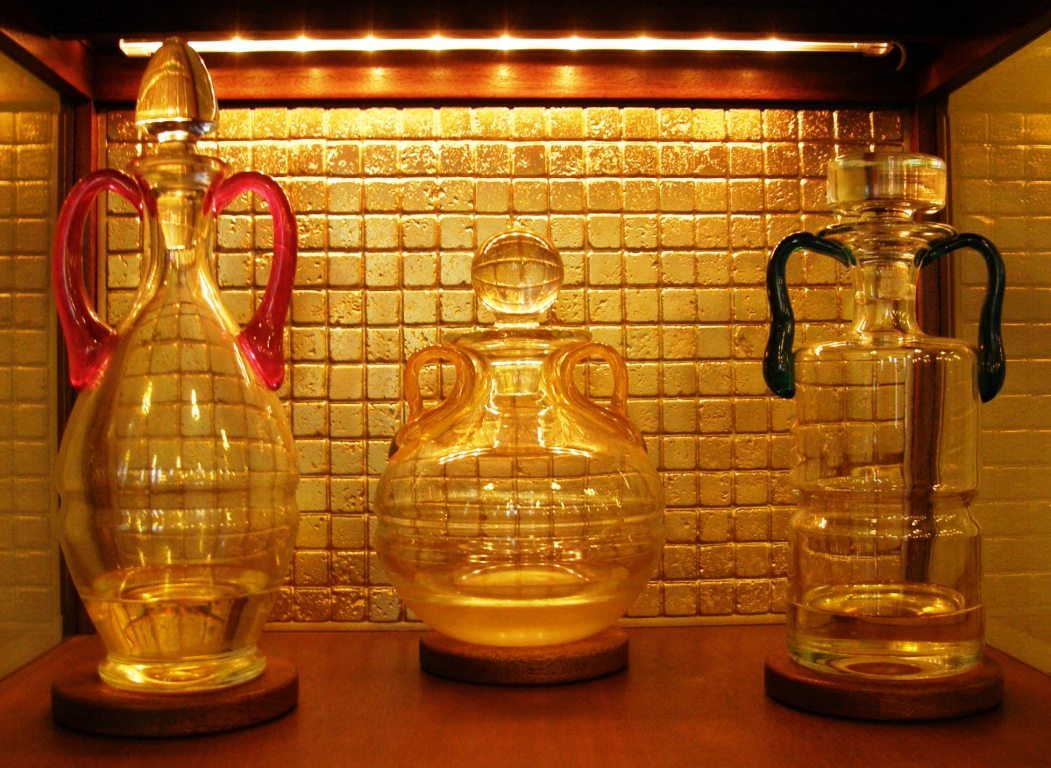 3 bottles of Sacred Chrism in an ambry