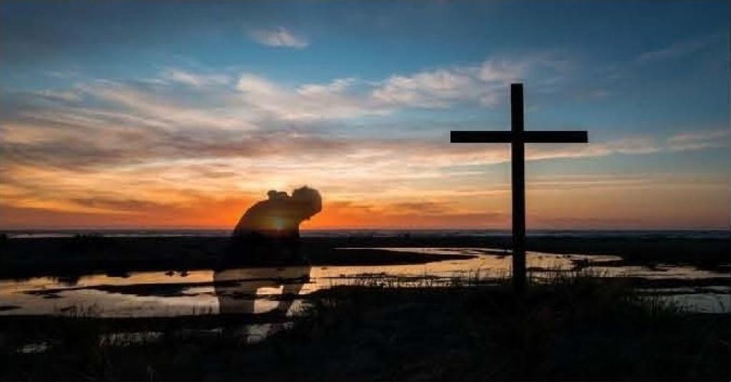 Kneeling at the Cross