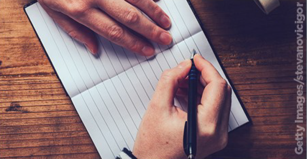 Hands writing in a notebook 452x234.png