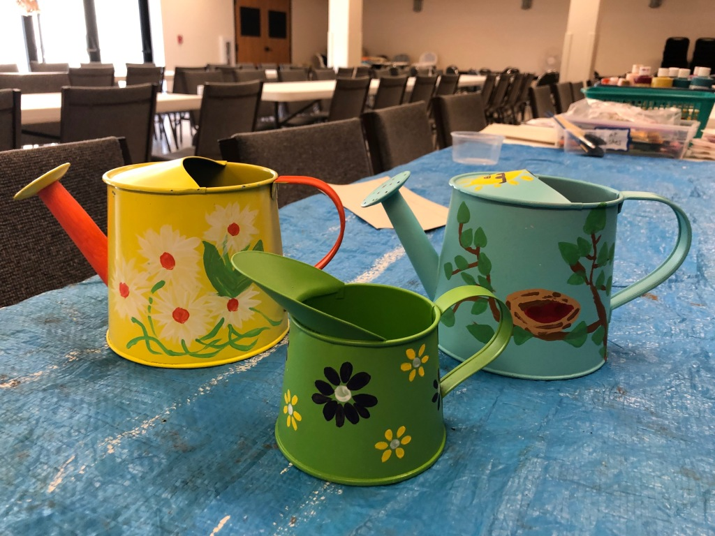 Watering Cans for Women service project at St. Anthony on the Lake