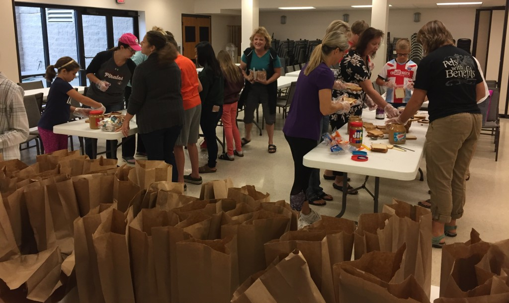 FaithWorks Making Lunches for the Gathering
