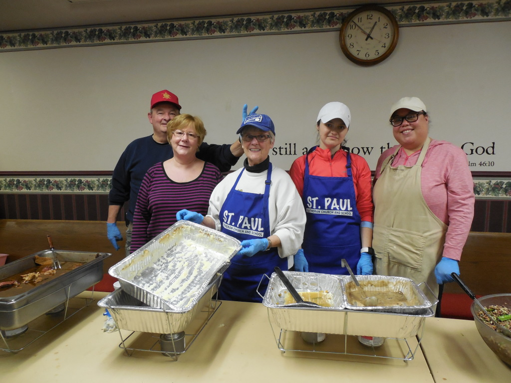 The Young Adult Ministry, accompanied by older parishioners, volunteers within the community.