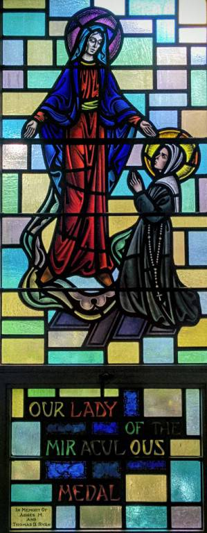 Part of a stained glass window depicting Our Lady of the Miraculous Medal