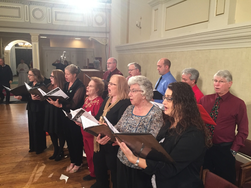 Members of Liturgical Choir sing at televised Mass
