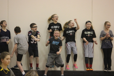 The crowd cheers at the Student vs. Faculty Volleyball Game