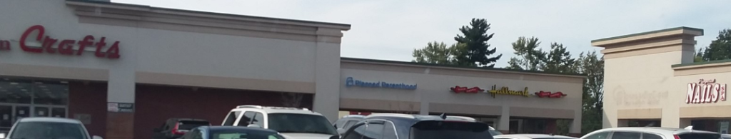 Planned Parenthood storefront between Ben Franklins Crafts and Hallmark